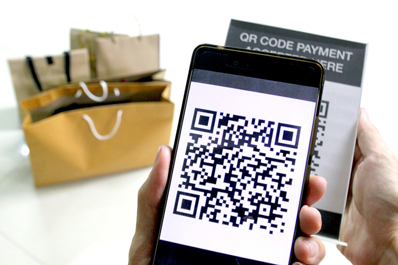 qr-code-payment-for-shopping-hand-holding-mobile-phone-to-scan-the-sign-of-qr-code-and-grant-money-to-another-account