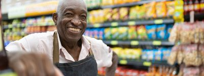 older-man-working-in-a-grocery-store